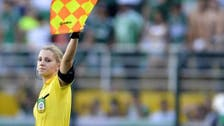 The beautiful game: Female Brazilian football ref becomes web sensation