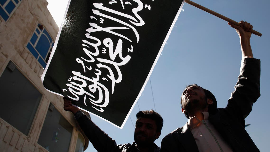 Protesters wave a flag as they demonstrate to denounce air strikes by U.S. drones outside the house of Yemen's President Abd-Rabbu Mansour Hadi in Sana reuters