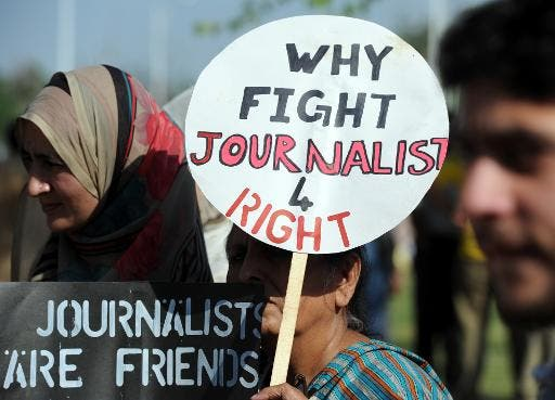 A file photo of Pakistani journalists hold placards during a protest against the attack on a journalist in Islamabad. (AFP)