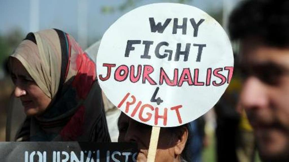 Pakistani journalists hold placards during a protest against the attack on Geo TV journalist Hamid Mir by gunmen in Islamabad on April 23, 2014 (AFP)