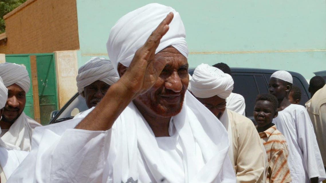 Sudan's former prime minister and opposition politician Sadiq al-Mahdi (R) was questioned but has not been formally charged pending further investigation into the claims. (File photo Reuters)