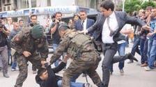 Turkey angered as Erdogan's aide kicks protester