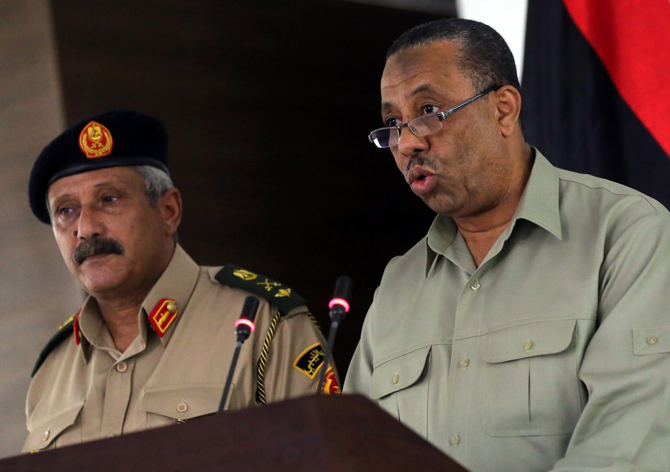 Chief of Staff of the Libyan Armed Forces, Major-General Abdessalem Jadallah al-Salihin (L) and Interim Prime Ministe rAbdullah al-Thani speaks during a press conference in Tripoli. (AFP)