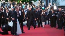 Video: Man dives under America Ferrera's dress on Cannes red carpet