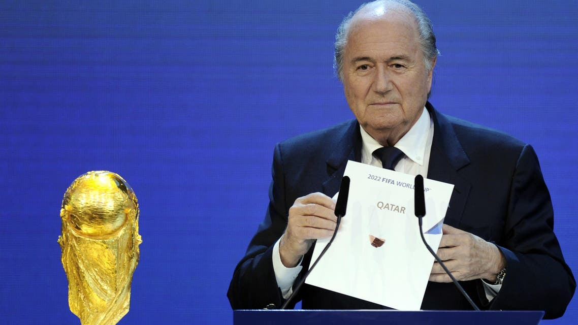 FIFA President Sepp Blatter holding up the name of Qatar during the official announcement of the 2022 World Cup host country at the FIFA headquarters in Zurich. (AFP)