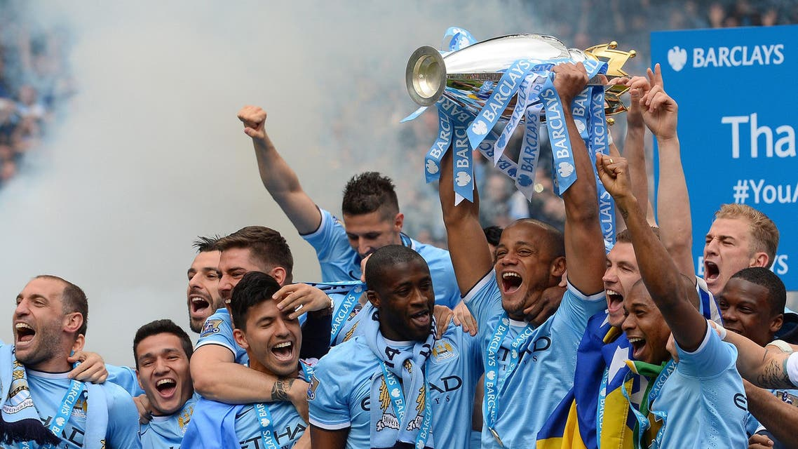 Manchester City players celebrate with the Premiership trophy on May 11, 2014. (AFP)