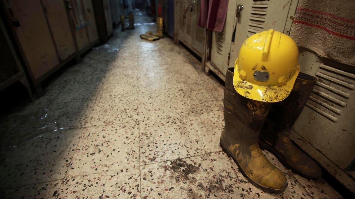 A boot and a helmet are seen in a changing room used by coal miners after a mining disaster in Soma, a district in Turkey's western province of Manisa May 14, 2014 reuters