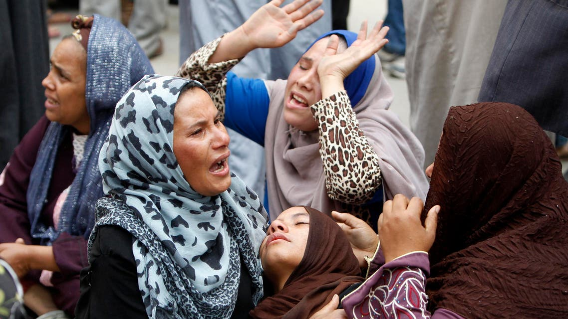Relatives and families of members of Muslim Brotherhood and supporters of ousted President Mohamed Mursi react after hearing the Minya court's death sentence on April 28, 2014. (Reuters)