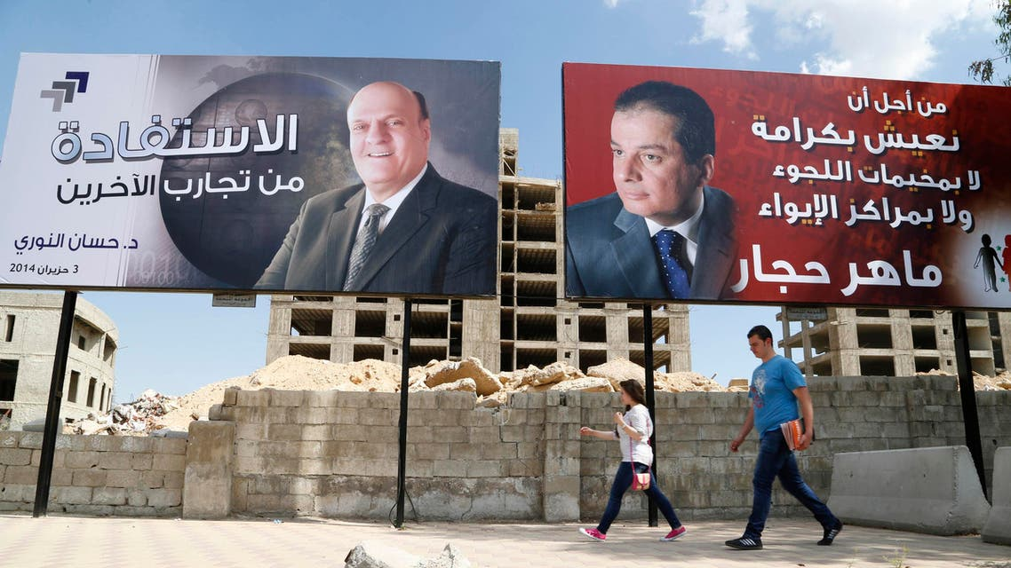 Election campaign posters for presidential candidate Maher Abdul-Hafiz Hajjar (R) and Hassan Abdallah al-Nouri are seen along a street in Damascus May 12, 2014. reuters