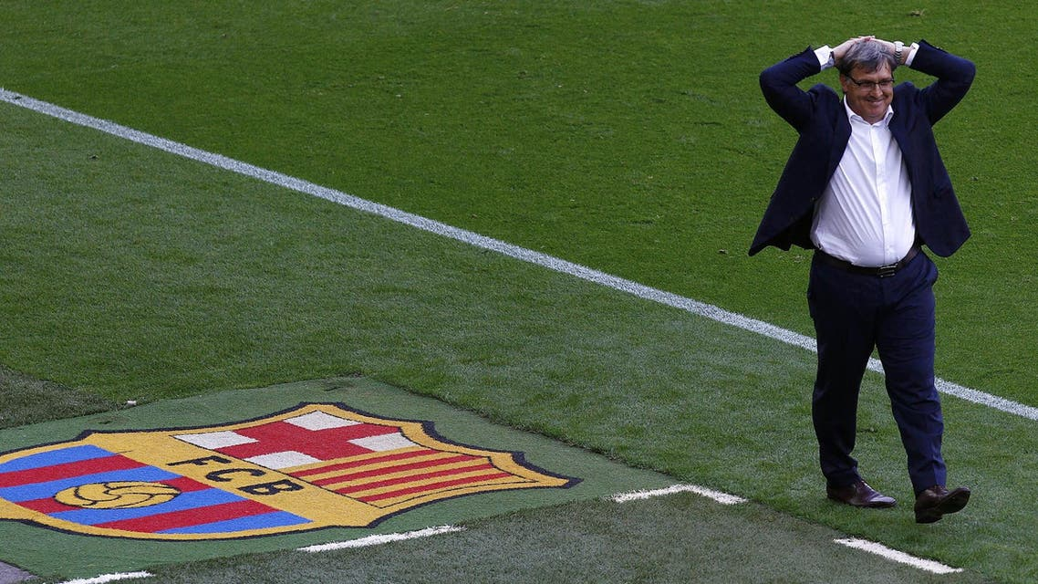 """Barcelona's Argentinian coach Gerardo """"Tata"""" Martino reacts during the Spanish league football match FC Barcelona vs Club Atletico de Madrid at the Camp Nou stadium in Barcelona on May 17, 2014. AFP"""