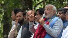 India's Modi mobbed by crowds on arrival in Delhi