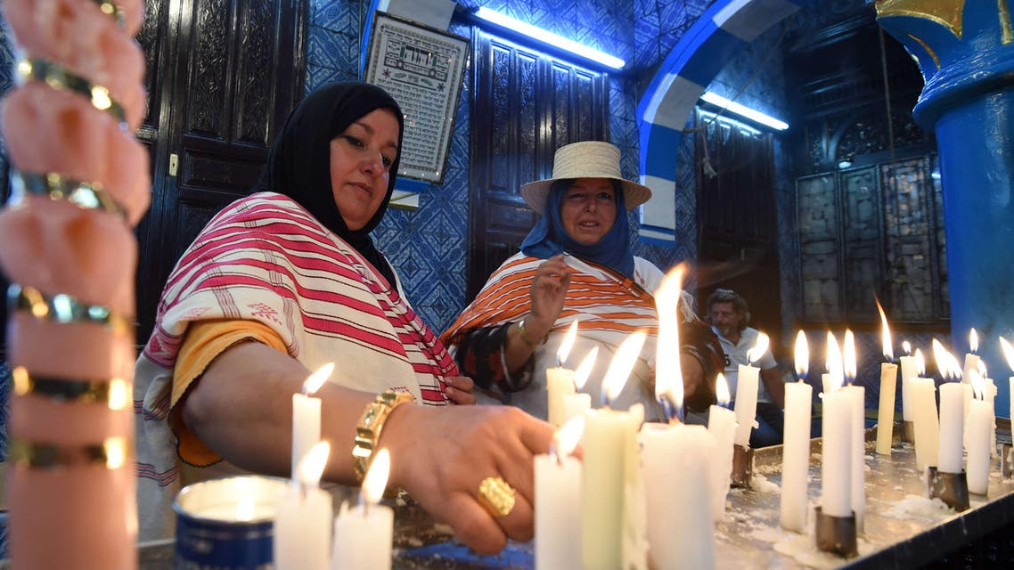 Jewish pilgrims light candles in the Ghriba synagogue on the Mediterranean resort island of Djerba on May 18, 2014. AFP