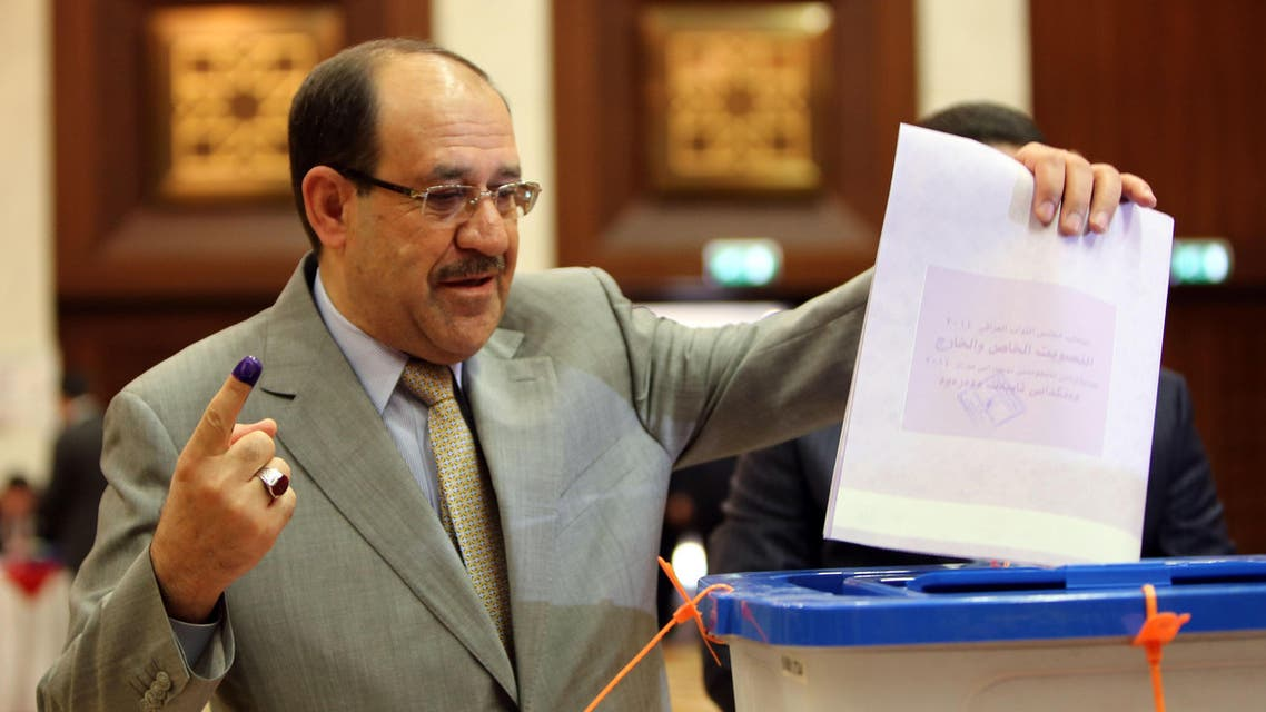 Iraqi Prime Minister Nuri al-Maliki casting his vote in Iraq's first parliamentary election since US troops withdrew at a polling station in Baghdad's fortified Green Zone. (AFP)