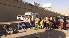 سقوط باص يقل 61 عاملاً من فوق كوبري بالرياض