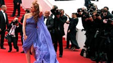 Cannes: Wind bedevils outfits on the carpet
