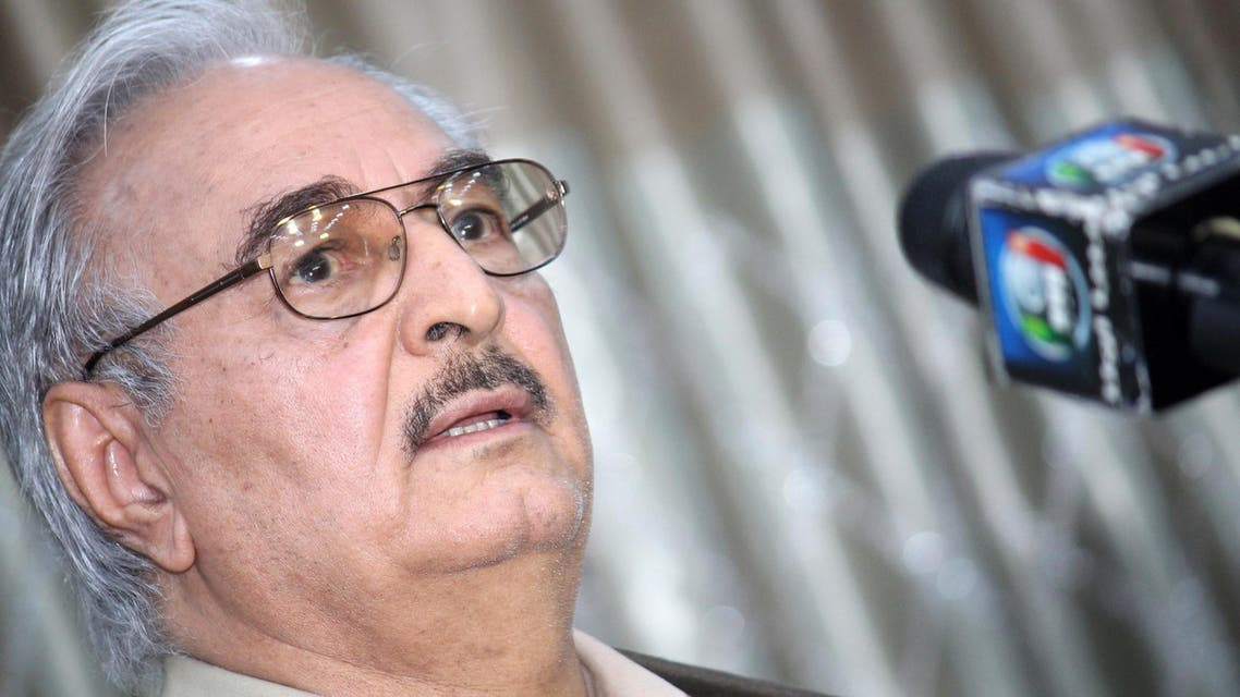 Retired Libyan Army general Khalifa Haftar speaks during a press conference in the town of Abyar, 70 km southwest of Bengahzi, on May 17, 2014. (AFP)