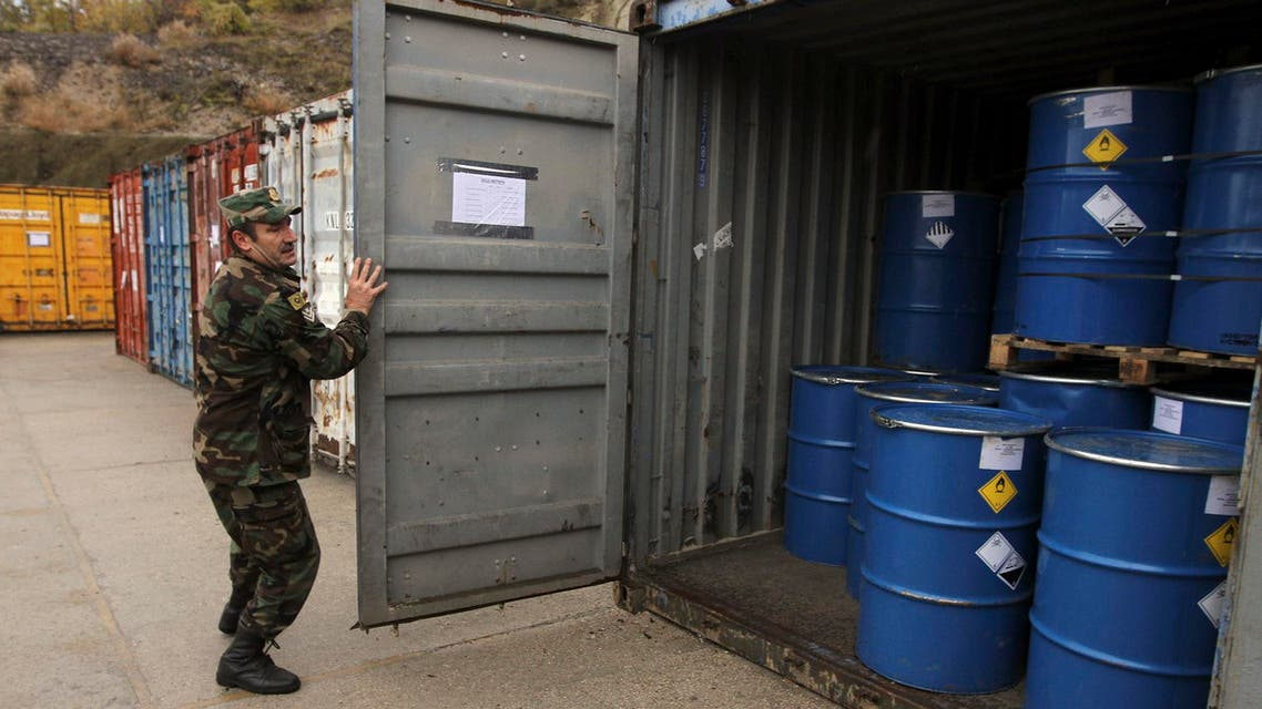 An Albanian soldier closes the door of a container, which according to officials from the Organisation for Security and Cooperation in Europe in Albania, contains newly-repackaged hazardous chemical waste at a military base in Qafe Molle, some 23 km (14 miles) from capital Tirana November 20, 2013.