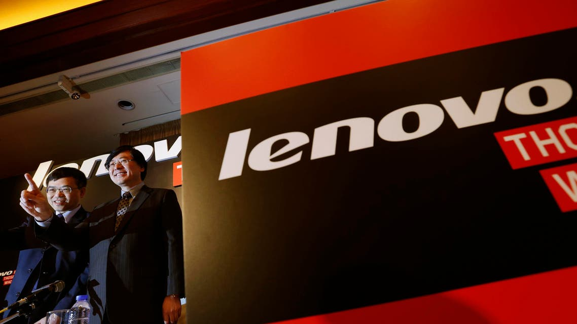 Lenovo Chairman and Chief Executive Officer Yang Yuanqing (R) gestures beside Chief Financial Officer Wong Wai-ming during a news conference announcing the company's annual results in Hong Kong May 21, 2014.  reuters