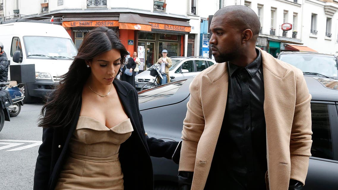 TV personality Kim Kardashian and rapper Kanye West arrive at a fashion designer workshop in Paris May 21, 2014. (Reuters)