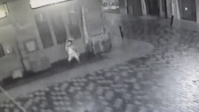 Shocking CCTV video shows 'hugger mugger' immobilizing his victim