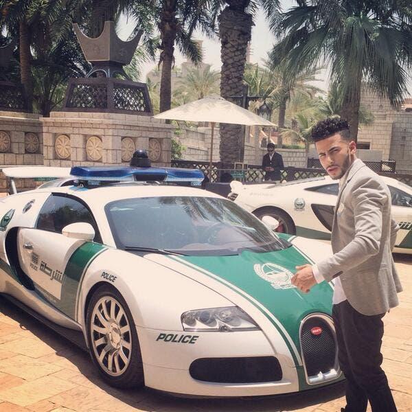 Adam Saleh at the Arab Media Forum with a Bugatti Dubai Police car. (Photo courtesy: Twitter)
