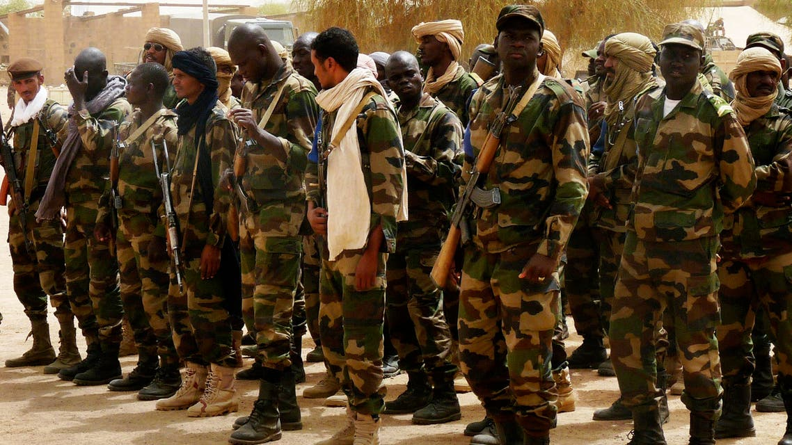 Malian soldiers line up in a military camp in the northern town of Kidal, July 17, 2013. (Reuters)
