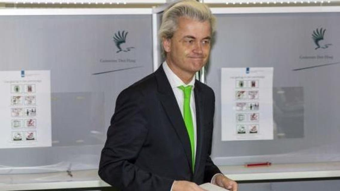 ar-right politician Geert Wilders of the anti-immigration Dutch Freedom (PVV) Party casts his vote during the European Parliament elections, in an elementary school in the Hague May 22, 2014.