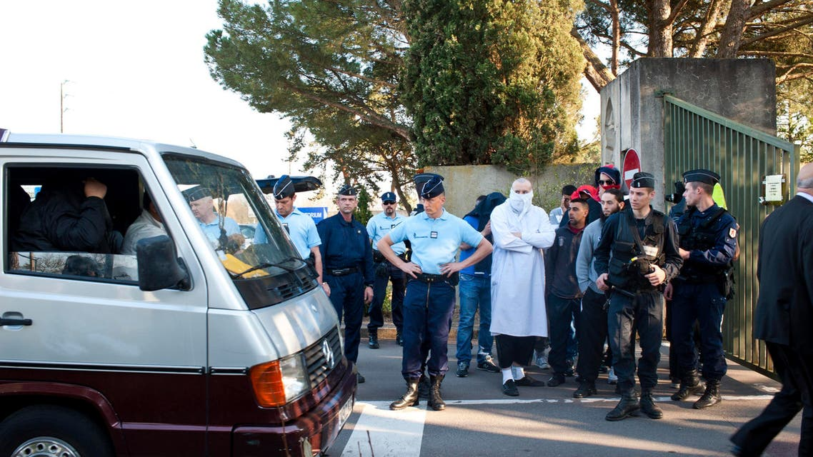 French gendarmes watch as the hearse carrying the coffin of Mohamed Merah, a Frenchman of Algerian origin who was shot dead following a more than 30-hour siege last week, arrives outside the cemetery in Cornebarrieu, near Toulouse, reuters