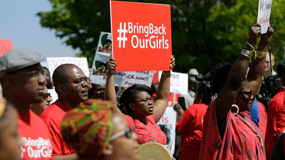 Protesters march in support of the girls kidnapped by members of Boko Haram in front of the Nigerian Embassy in Washington May 6, 2014. Reuters