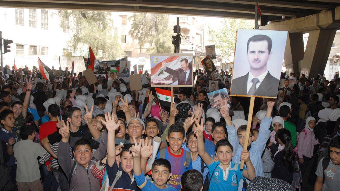 Children attend a rally in support of Syria's President Bashar al-Assad and the army at al-Zahera neighbourhood in Damascus April 7, 2014, in this handout photograph released by Syria's national news agency SANA .  Reuters