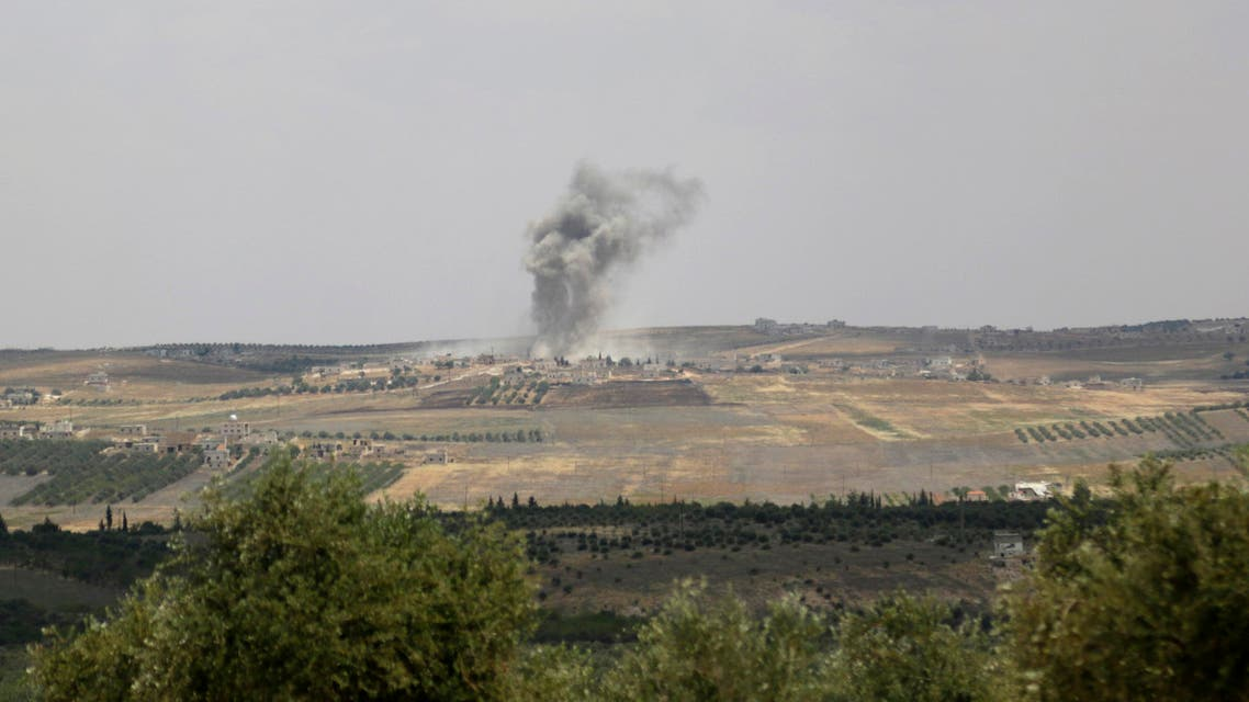 Smoke rises from Kvrbasin, in what activists say was shelling by forces loyal to the Syrian regime after Free Syrian Army fighters claim they took control of the village, Idlib countryside May 24, 2014. (Reuters)