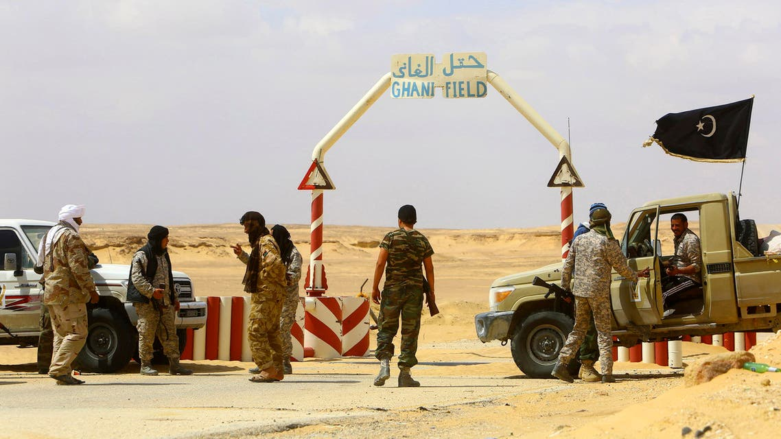Rebels under Libyan rebel leader Ibrahim Jathran guard the entrance of the al-Ghani oil field, which is currently under the group's control, south of Ras Lanuf March 18, 2014. (Reuters)