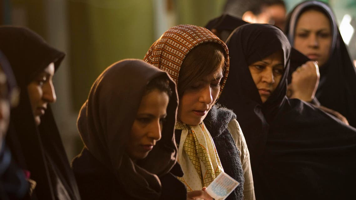 Women wait in line to vote for the parliamentary election in a mosque in south Tehran March 2, 2012. (Reuters)