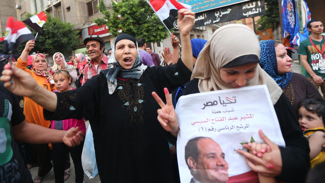 Egyptian supporters of former army chief and presidential candidate Abdel Fatah al-Sisi (portrait) wave their national flag and chant slogans in a street in Cairo on the second day of Egypt's presidential election May 27, 2014. (AFP)