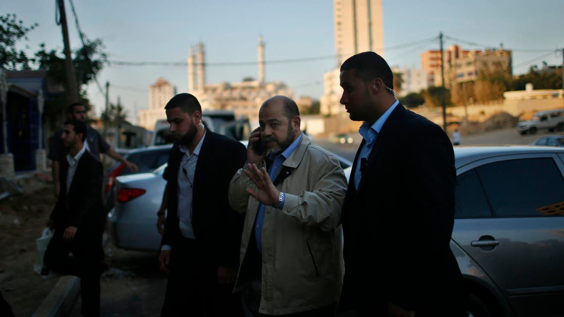 Senior Hamas leader Moussa Abu Marzouq arrives to meet with senior Fatah official Azzam Al-Ahmed in Gaza City May 26, 2014.