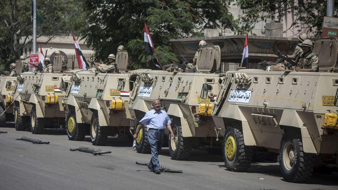 People walk in a market near an electoral banner for presidential candidate and former army chief Abdel Fattah al-Sisi during the third day of voting in the Egyptian presidential election in Cairo May 28, 2014. (AFP)
