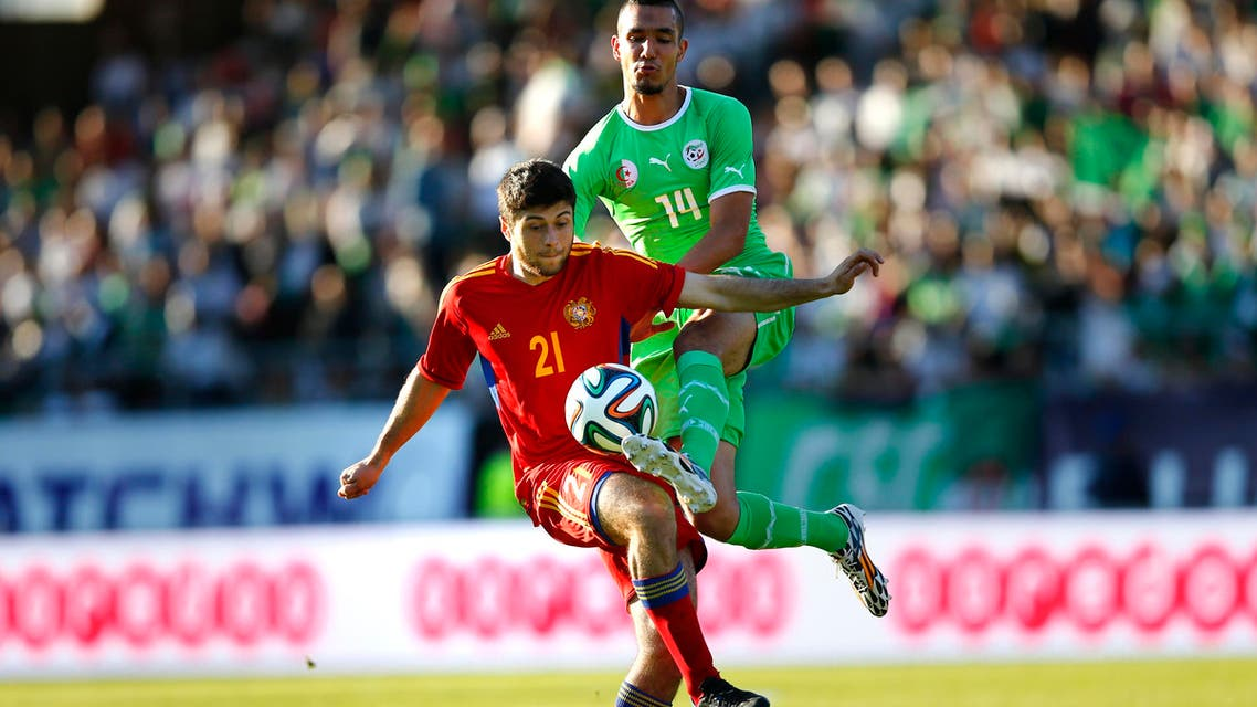 Armenia's Aleksandr Tumasyan (L) fights for the ball with Algeria's Nabil Bentaleb during their international friendly soccer match at the Tourbillon stadium in Sion May 31, 2014. (Reuters)