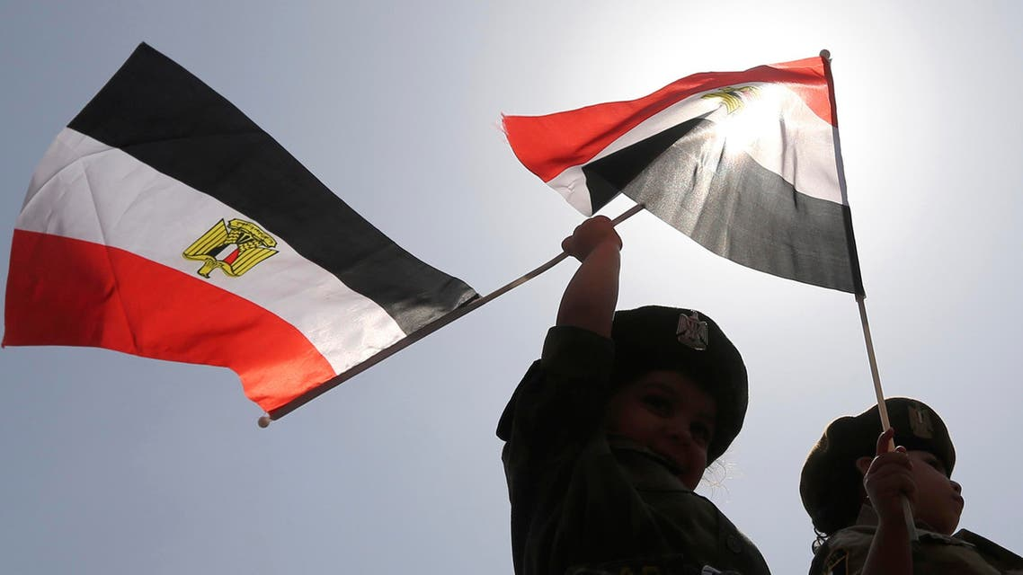 Children in army uniforms wave Egyptian flags outside a polling station on the second day of voting in the Egyptian election in Cairo, May 27, 2014.  (Reuters)