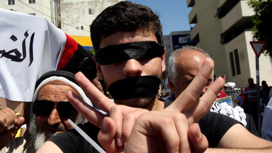 A blindfolded Palestinian has his hands tied as he takes part in a demonstration to show solidarity with Palestinian prisoners held in Israeli jails, on May 26, 2014.  (Reuters)