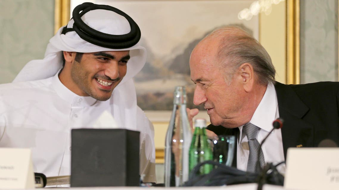 FIFA President Sepp Blatter (R) speaks with Qatar's 2022 World Cup bid Chief Sheikh Mohammed Al-Thani at a news conference in Doha November 9, 2013. (Reuters)