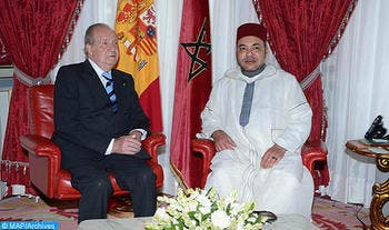 Morocco's King Mohammad VI seen seated with Spanish King Juan Carlos. (Photo courtesy of MAP)