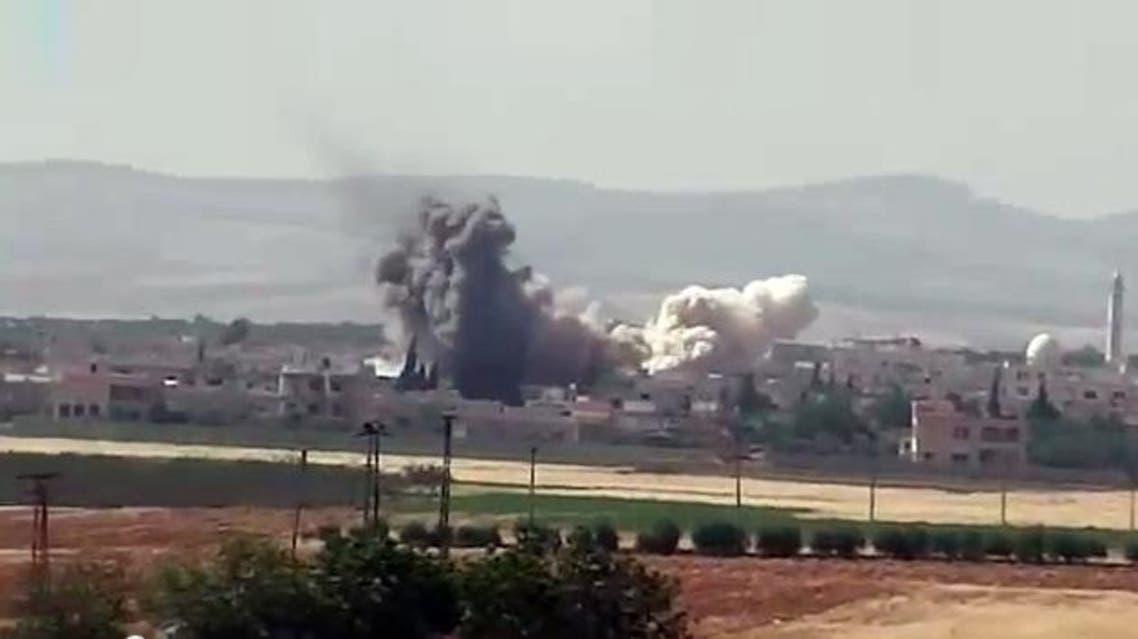 قصف بالبراميل المتفجرة على مدينة كفرزيتا