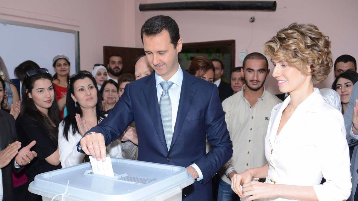 Syria's President Bashar al-Assad and his wife Asma cast their votes in the country's presidential elections at a polling station in Damascus June 3, 2014, in this handout released by Syria's national news agency SANA.(Reuters)