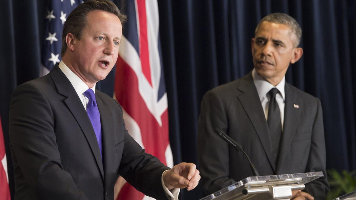 US President Barack Obama (R) and British Prime Minister David Cameron hold a joint press conference during the G7 Summit at the European Council in Brussels, on June 5, 2014. (Reuters)