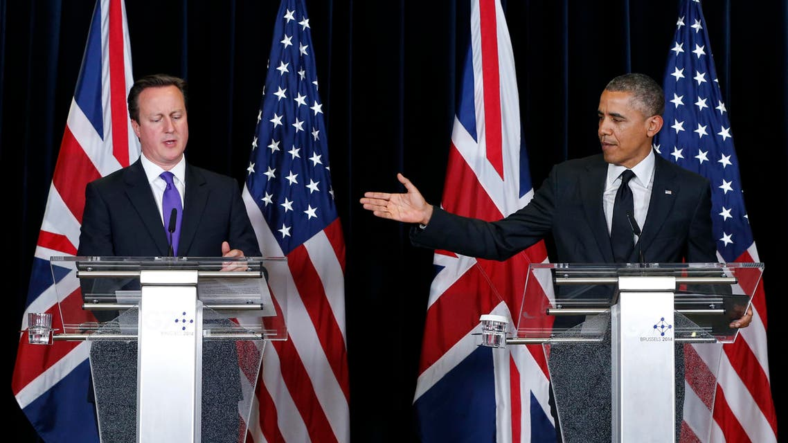 Britain's Prime Minister David Cameron (L) and U.S. President Barack Obama (R) hold a joint news conference at the end of a G7 leaders meeting at European Council headquarters in Brussels June 5, 2014. (Reuters)