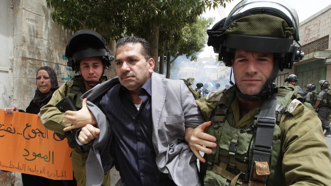 Israeli soldiers detain a Palestinian demonstrator during a protest against Israeli settlements and in support of Palestinian inmates held in Israeli jails who are in hunger strike, on June 5, 2014. (Reuters)