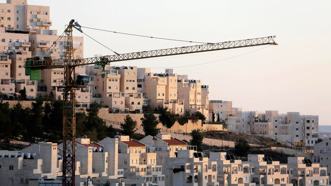 A crane is seen next to homes in a Jewish settlement near Jerusalem known to Israelis as Har Homa and to Palestinians as Jabal Abu Ghneim reuters