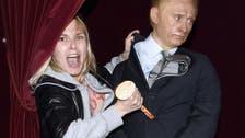 Femen activist strikes the heart of Putin's statue