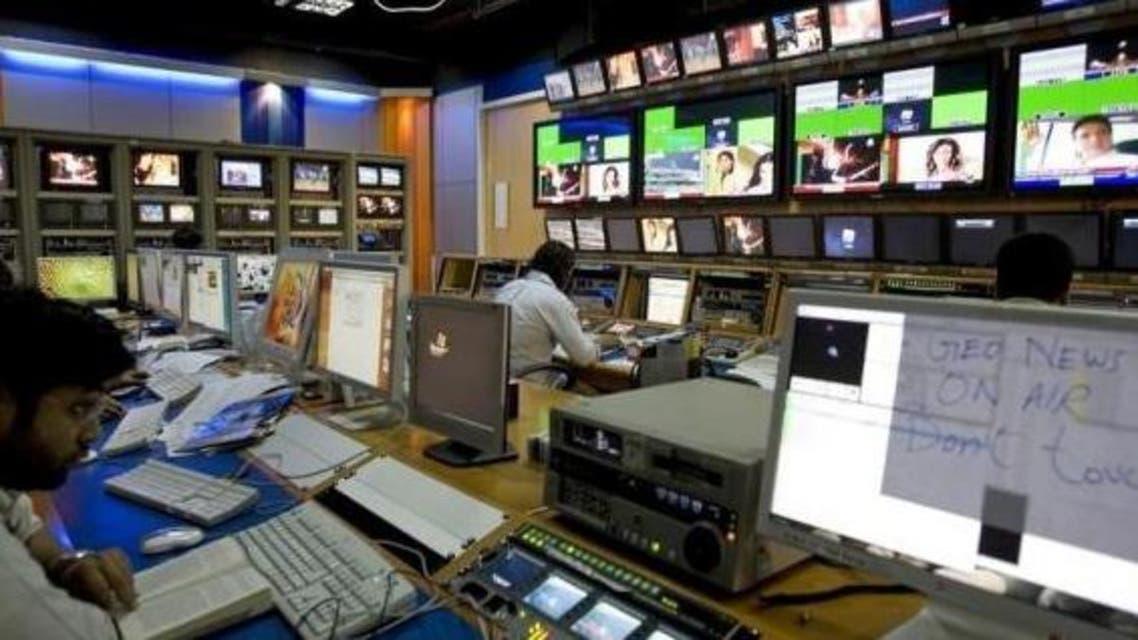 TV producers work at a control room of Geo News, a Dubai-based Pakistani television network, in Dubai November 18, 2007.