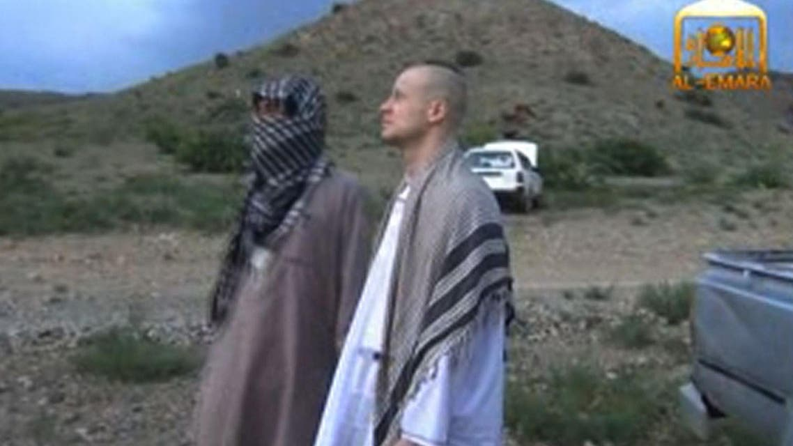 U.S. Army Sergeant Bowe Bergdahl (R) waiting at an undisclosed location in Afghanistan before his handover to US forces after five years in captivity. (AFP)